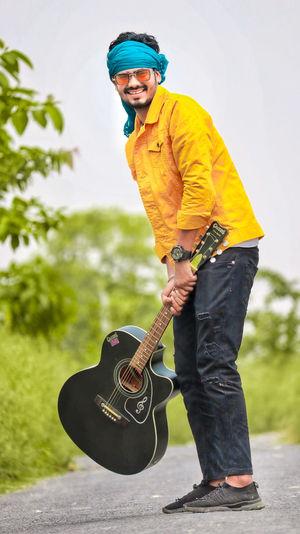 Man holding guitar