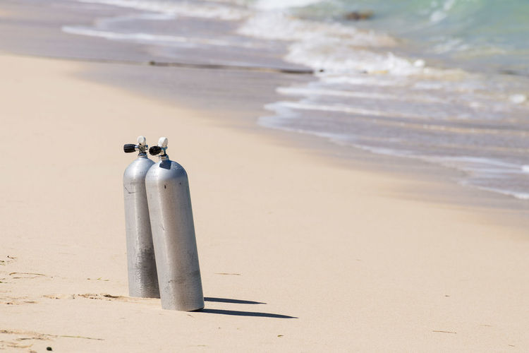 Diving cylinders on beach
