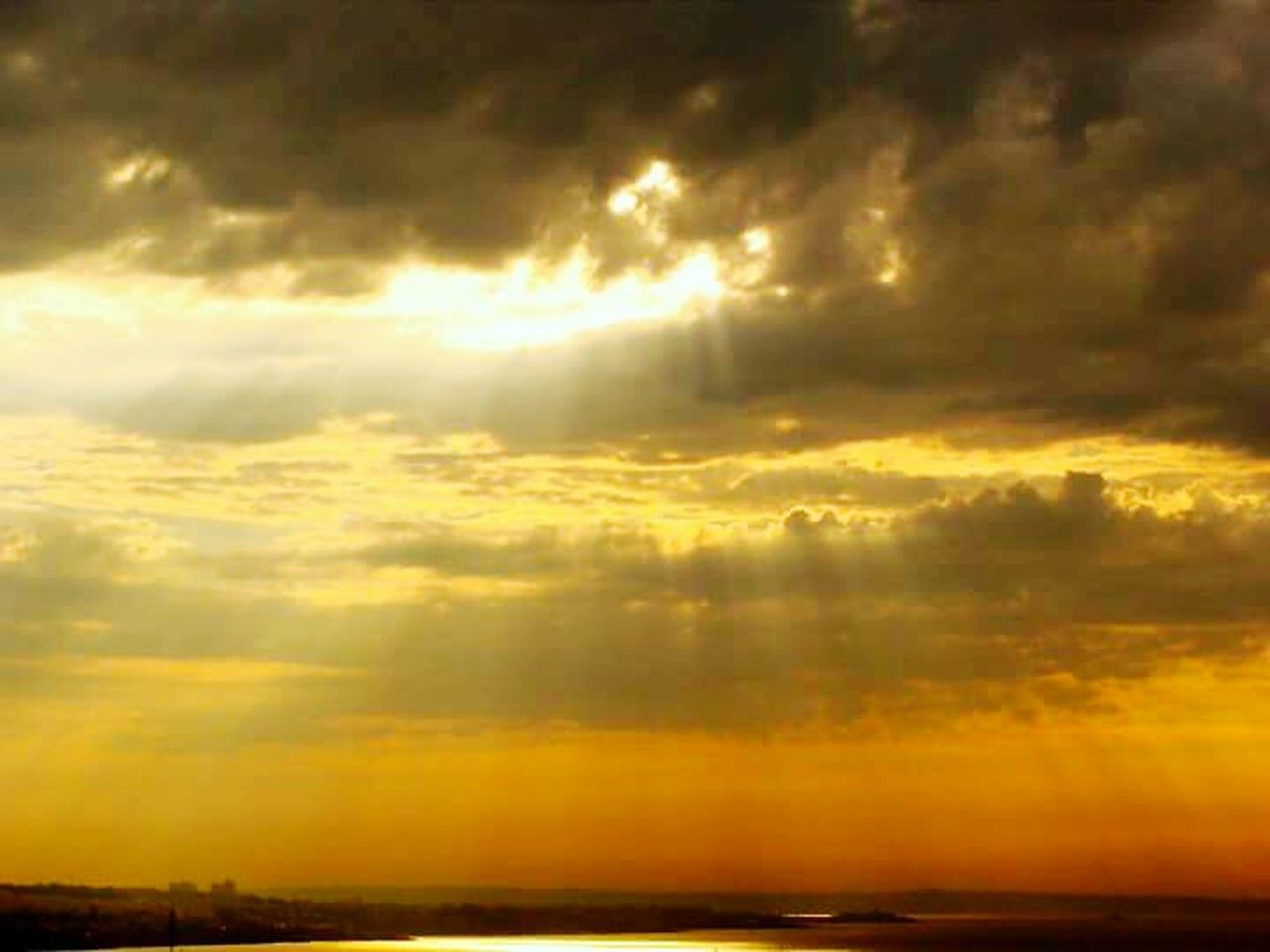 sunset, scenics, nature, sky, dramatic sky, cloud - sky, beauty in nature, sunbeam, yellow, weather, tranquility, tranquil scene, outdoors, no people, storm cloud, day