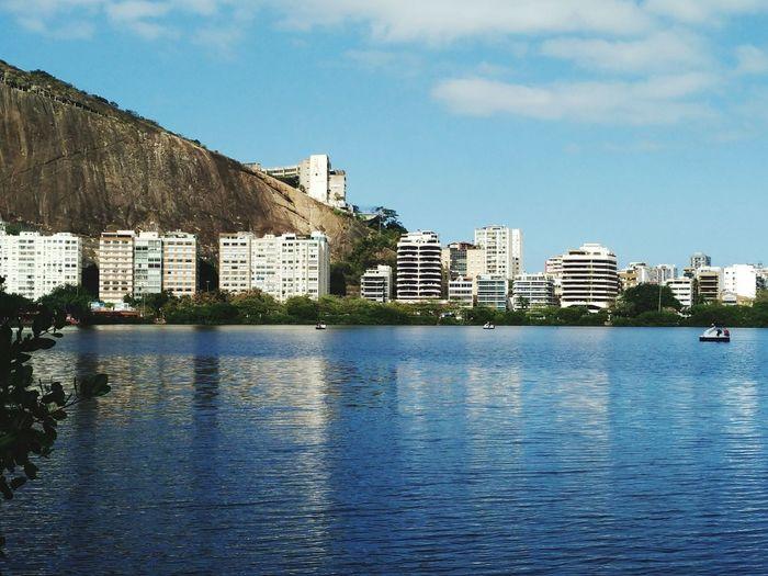 Cityscape by lagoa rodrigo de freitas against sky