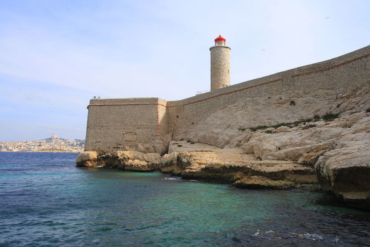 Lighthouse on building by sea