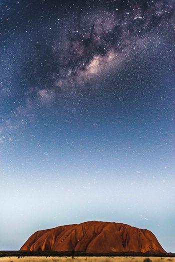 Rocky mountain against star field sky