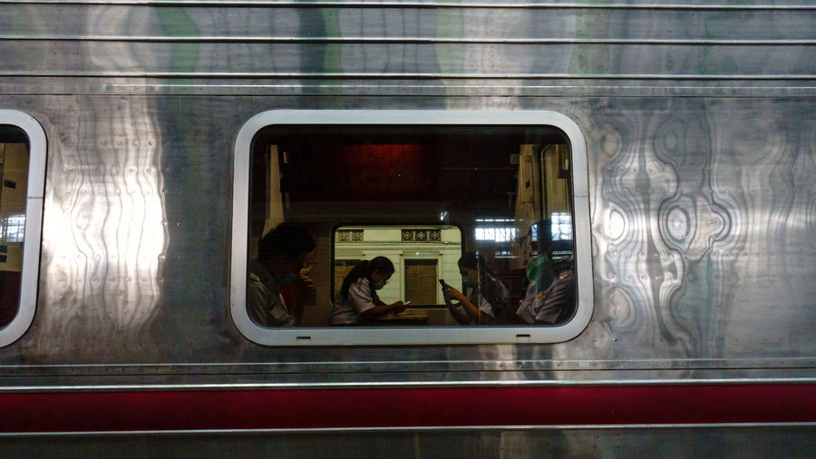 Rear view of people traveling in train