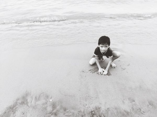 EyeEm Selects Sand Childhood Beach Boys Full Length Child Vacations Outdoors Looking At Camera One Person Eyeem Philippines Portrait Children Only Summer Sea Nature Real People Sand Pail And Shovel People