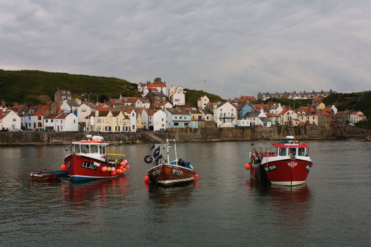 Staithes fishing boats in harbour Staithes Seascape Trawler Fishing Boats Transportation Nautical Vessel No People Sky Waterfront Sea Copy Space In Sky EyeEm Best Shots EyeEmNewHere EyeEm Gallery Eyemphotography