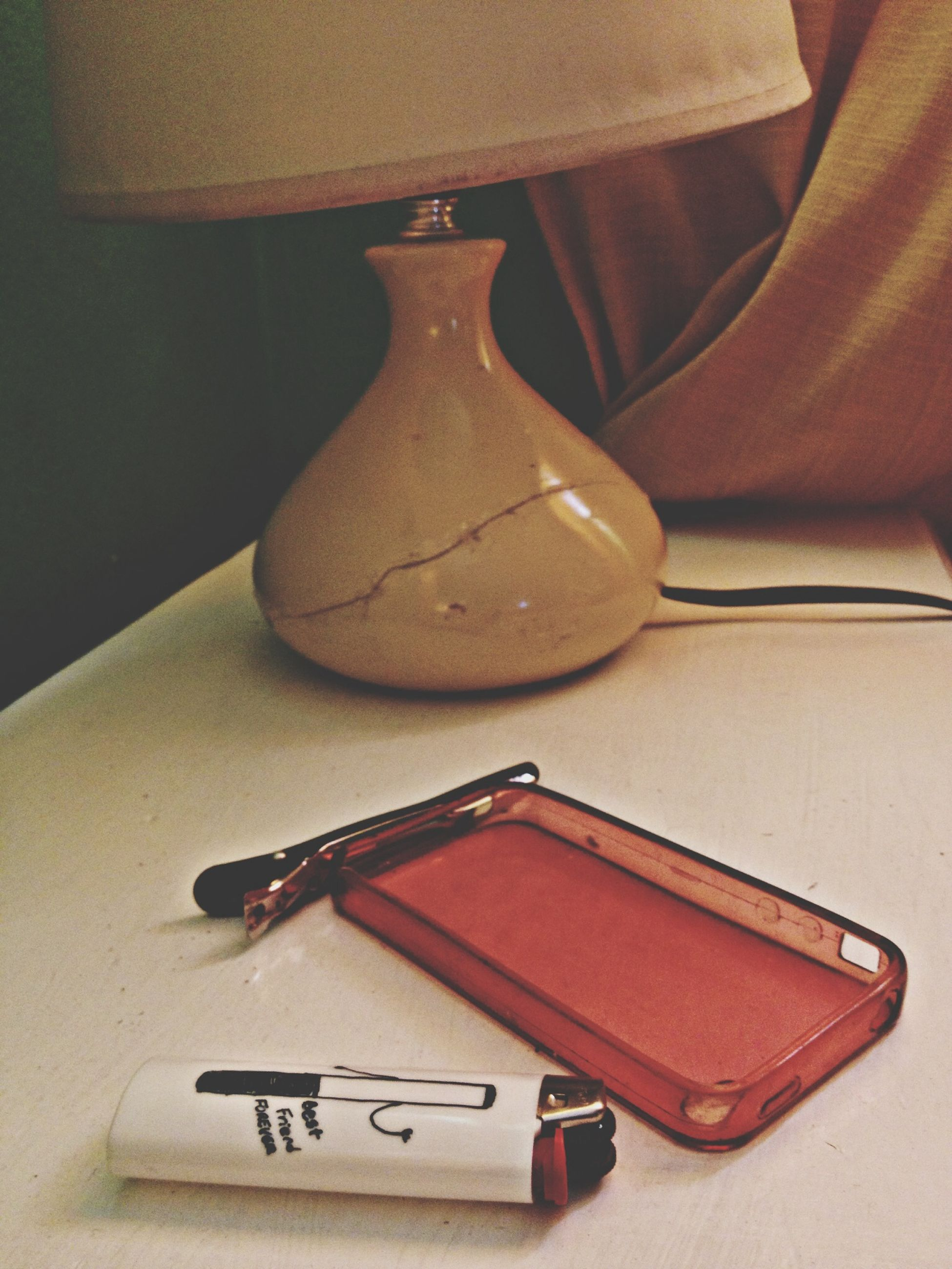 indoors, still life, table, high angle view, close-up, music, musical instrument, arts culture and entertainment, single object, no people, wood - material, fashion, technology, paper, old-fashioned, book, work tool, communication, studio shot, education