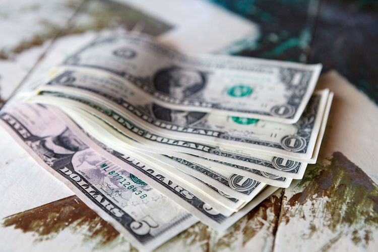 Money - USD one dollar bills on vintage table American Banking Bill Cash Close-up Currency Currency Debt Dollars Loan  Money No People One Dollar Bill Paper Paper Currency Salary Salaryman Savings USD Vintage Wage Washington Wealth