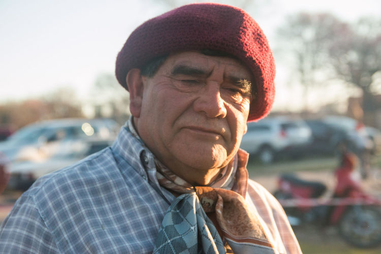 Portrait of senior adult man wearing traditional clothing
