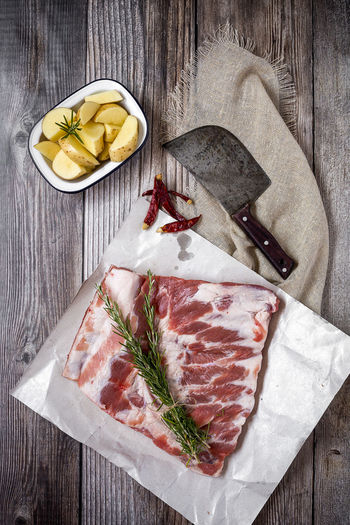 Close-up Cutting Board Directly Above Food Food And Drink Freshness Fruit Healthy Eating High Angle View Indoors  Kitchen Knife Knife Meat No People Paper SLICE Snack Steak Still Life Table Table Knife Wood - Material