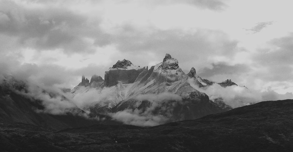 In the mountains Grain Black And White Patagonia Mountain Range Mountain Sky Cloud - Sky Flying Nature No People Day Low Angle View Mid-air Tree Beauty In Nature Outdoors Environment Land