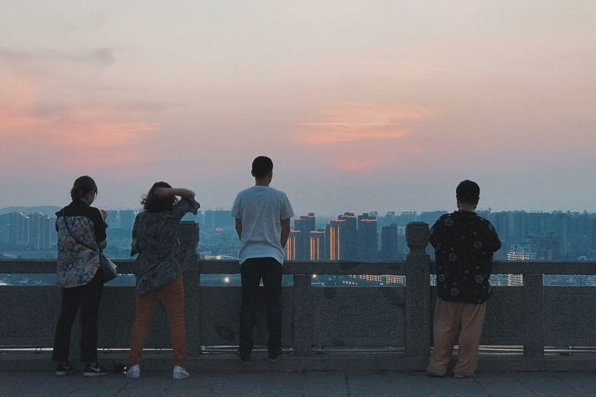 Sunset Standing Sky Water Men Sea Real People Leisure Activity Women Friendship Lifestyles Full Length Rear View Outdoors Togetherness Nature Cityscape City Beauty In Nature Day