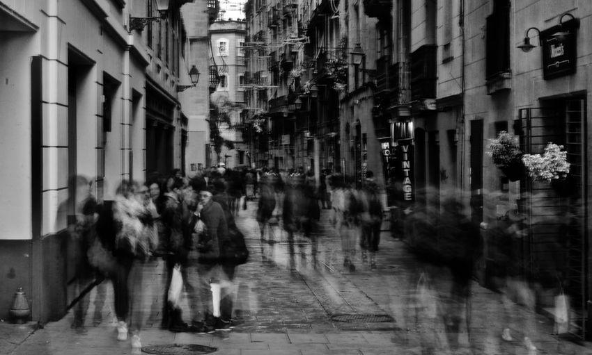 People on wet street in city