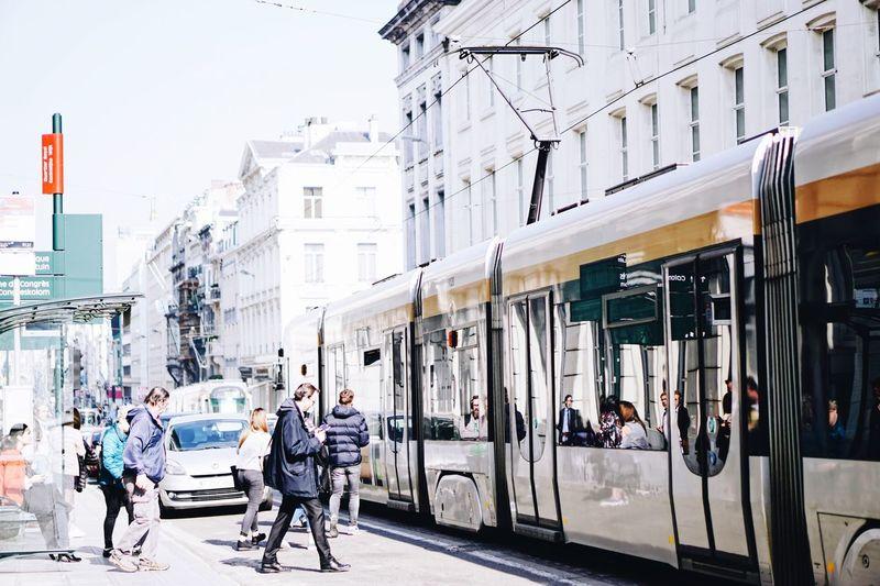 People Walking In City Against Sky