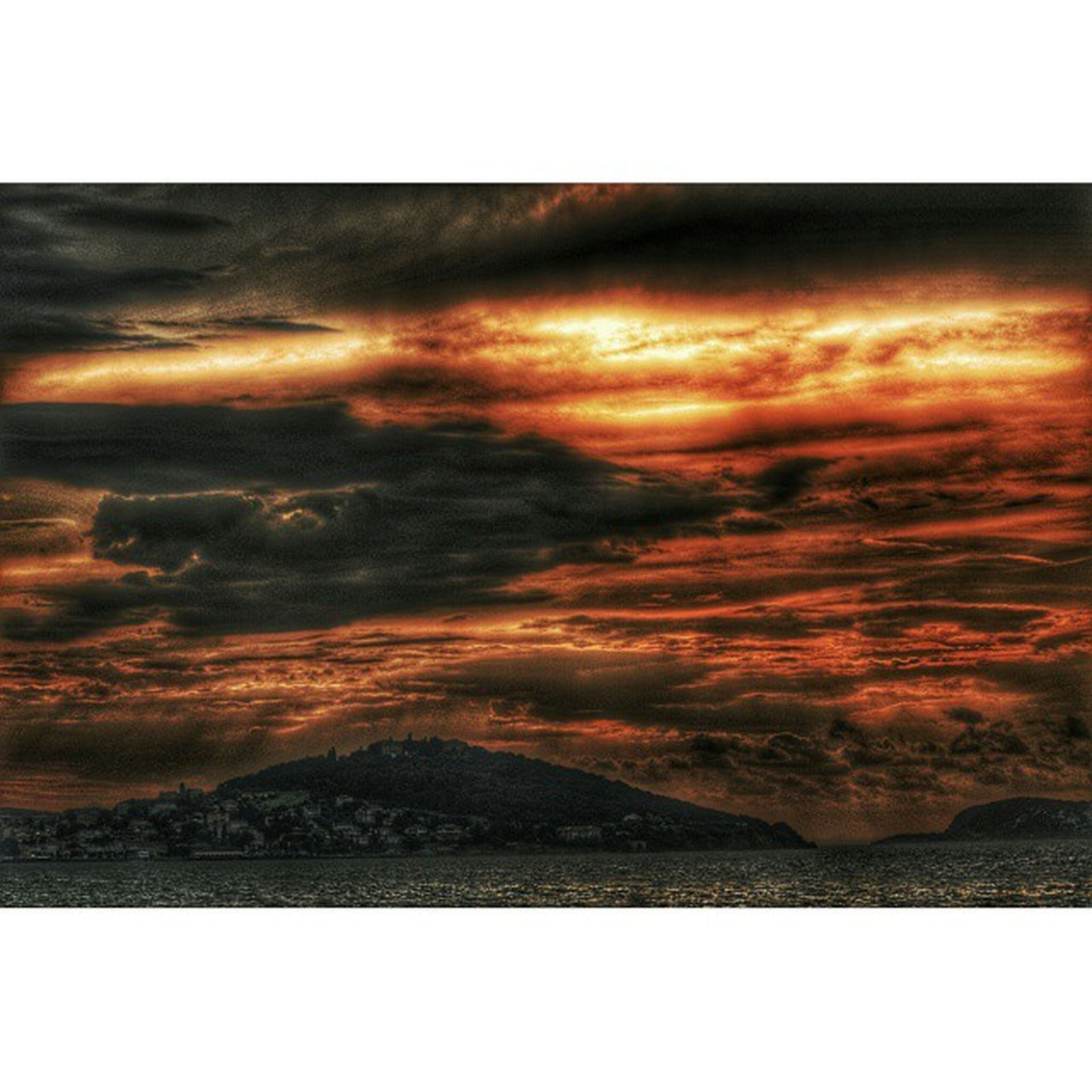 transfer print, sunset, scenics, auto post production filter, tranquil scene, sky, tranquility, beauty in nature, cloud - sky, nature, orange color, idyllic, cloudy, dramatic sky, weather, landscape, cloud, outdoors, overcast, majestic