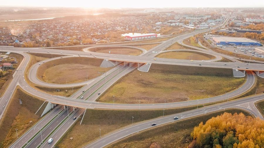 Aerial View High Angle View Landscape Nature Road Environment Day Outdoors Sunlight Highway Agriculture Scenics - Nature Built Structure Land Transportation City Travel Architecture Plant No People