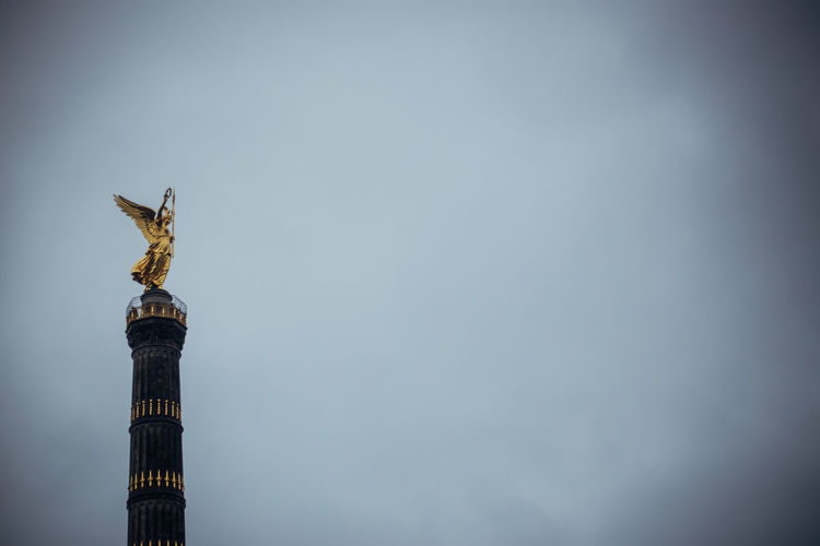 Low angle view of victory column against clear sky