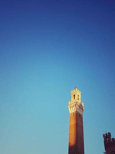 Copy Space No People Sky Blue Travel Destinations Outdoors Day Clock Tower Architecture Clear Sky Innovation Illuminated Cityscape Urban Skyline City Clock Torre Del Mangia Piazza Del Campo Piazza Del Campo. Siena Siena..❤ Siena Tuscany Siena, Italy Siena Italy Siena Postcode Postcards