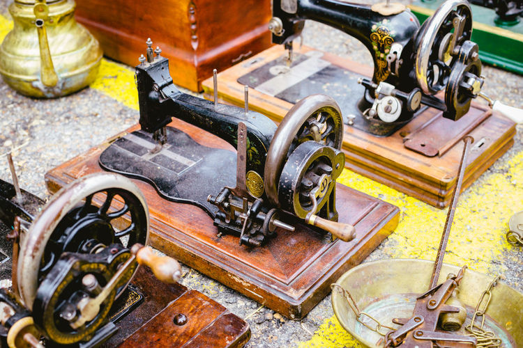 Close-Up Of Old-Fashioned Sewing Machines