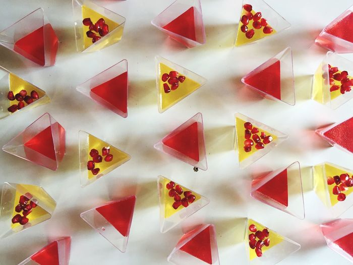 Directly above shot vodka jelly drinks on triangle shape glasses on table