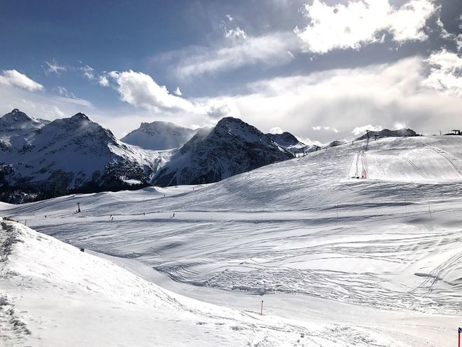 Snow Cold Temperature Winter Mountain Beauty In Nature Sky Cloud - Sky Scenics Nature Mountain Range Landscape Outdoors Day No People Skiing Clouds And Sky Snowcapped Mountain Non-urban Scene Ski Holiday Beauty In Nature Winter Tranquility Idyllic Tourism Adventure