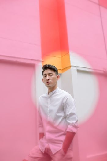 Portrait Photography Portrait Of A Man  Creative Photography Pink Color One Person Young Men Young Adult Standing Three Quarter Length Looking Away Front View Wall - Building Feature Men Portrait
