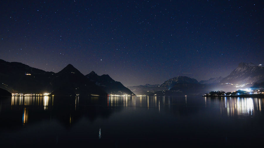 Scenic view of lake against sky full of stars at night