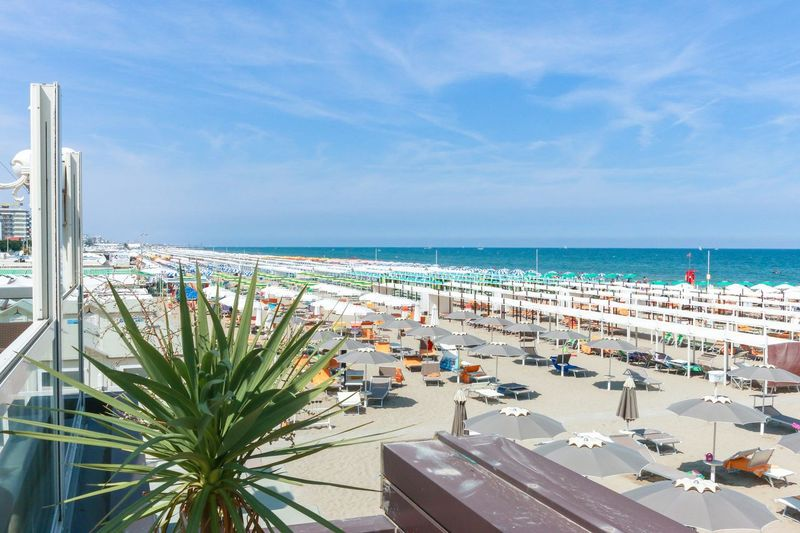 View from the terrace of the restaurant to the beach and the sea, Italy, Riccione Italy. Riccione Emiliaromagna Riccione Rimini Italy High Angle View Horizon Resort Vacation Sand Umbrella Sunshade Sunbed Beach Sea Horizon Over Water Beach Sky Vacations Water Beauty In Nature Day Outdoors Travel Destinations Sand Palm Tree No People