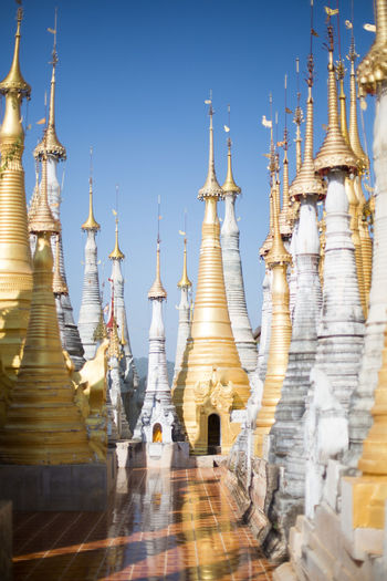 Shwe Inn Dein Pagoda, Inle Lake, Myanmar Buddha Architecture Belief Buddhism Buddhist Temple Building Building Exterior Built Structure Clear Sky Day Inle Lake Low Angle View Myanmar Nature No People Outdoors Place Of Worship Religion Sky Spire  Spirituality Temple Travel Travel Destinations