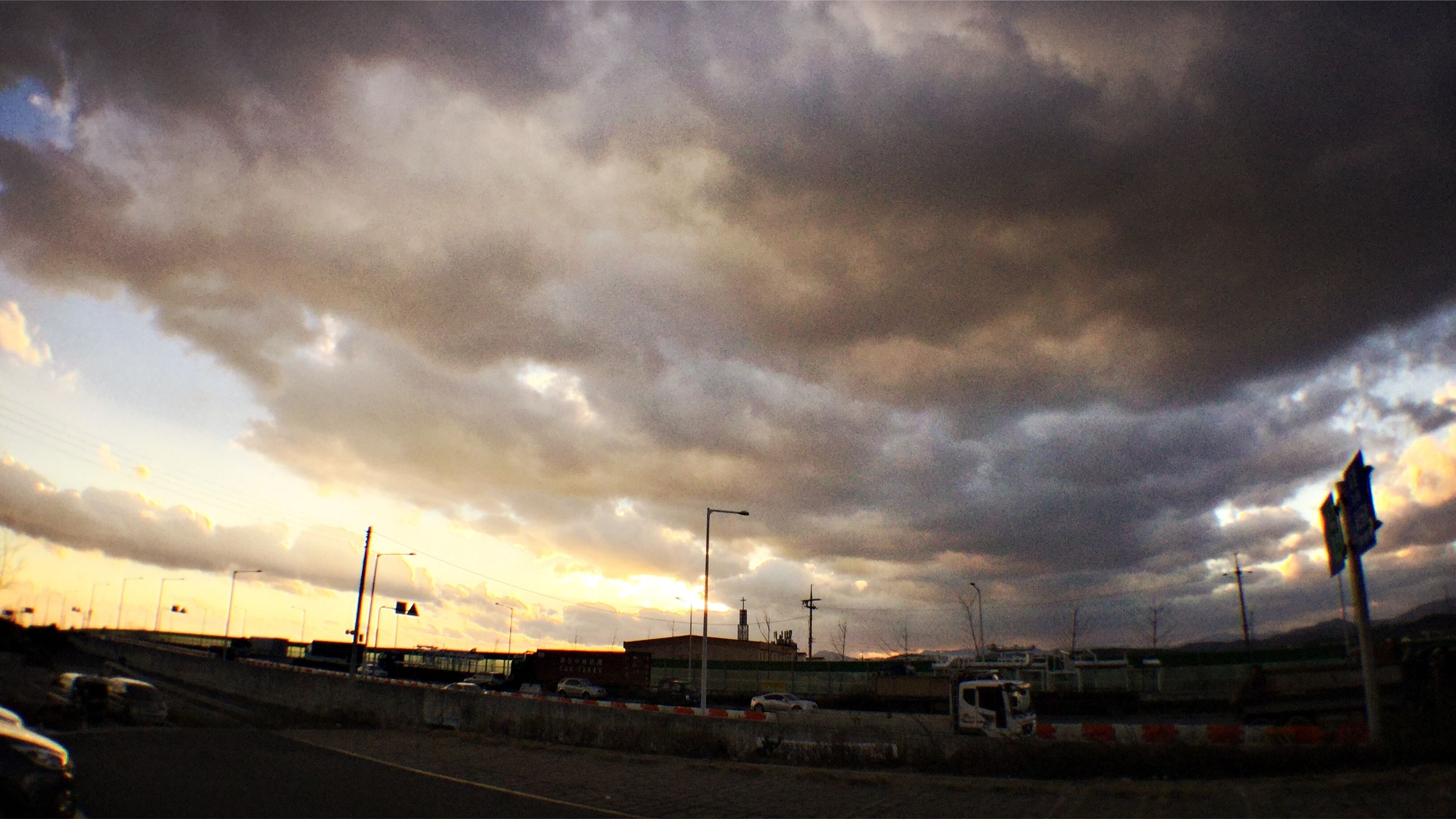 transportation, sky, cloud - sky, mode of transport, road, land vehicle, cloudy, car, road marking, sunset, the way forward, weather, cloud, overcast, dramatic sky, on the move, street, storm cloud, dusk, silhouette