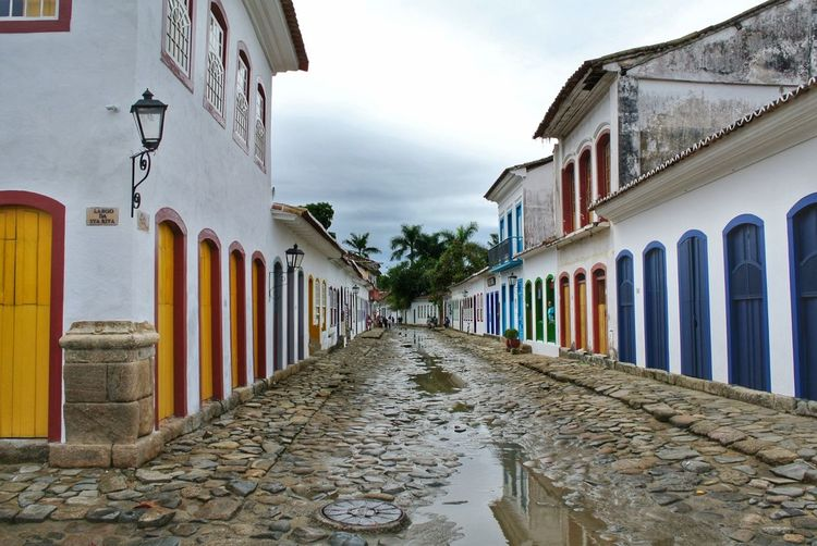 Paraty 9. Brazil. Colorful Rainy Days Beautiful EyeEm Best Shots Cityscape TOWNSCAPE Sightseeing Travel Paraty Brazil Rio De Janeiro Rio De Janeiro Eyeem Fotos Collection⛵ Colonial Colonial Architecture Portugal Historic Oldtown Multi Colored Sky Architecture Building Exterior Built Structure Cloud - Sky Cobblestone Townhouse Walkway Paved Diminishing Perspective vanishing point Pathway