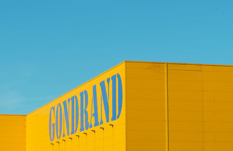 Building in contrast Architecture Built Structure Blue Copy Space Yellow Building Exterior Building Low Angle View Clear Sky Wall - Building Feature Sky No People Day Sunlight Striped Pattern Side By Side Industry Complementary Colors Nikon Nikonphotography Architecture Architectural Column Minimalism Minimalist Architecture My Best Photo The Minimalist - 2019 EyeEm Awards The Architect - 2019 EyeEm Awards