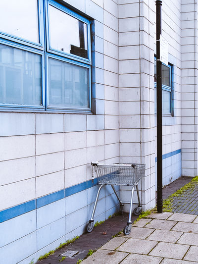 Compact Digital Camera Trolley Absence Blue Brick Cart City Consumerism Footpath No People Point And Shoot Retro Camera Shopping Sidewalk Space For Text Street Tile
