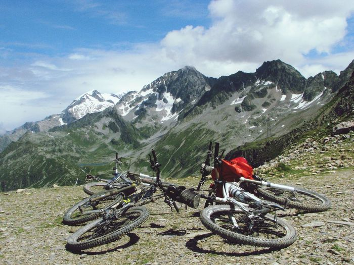 Bicycles On Field Against Mountains Against Sky