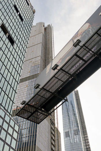 New and modern skyscrapers and buildings in NYC Built Structure Architecture Building Exterior Building Office Building Exterior Low Angle View City Modern Sky Skyscraper Office Tall - High No People Tower Day Glass - Material Nature Outdoors Cloud - Sky Travel Destinations