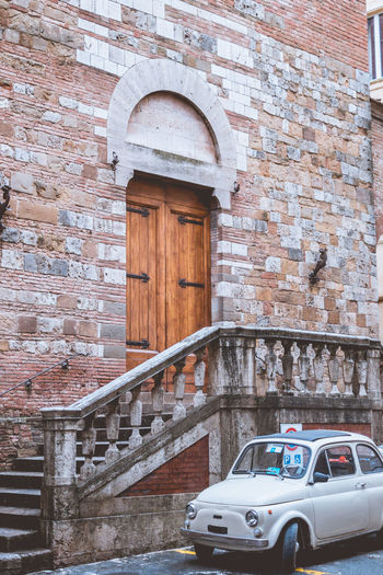 Beautiful town of Siena in the middle of Tuscany, Italy. Architecture Built Structure Building Exterior Wall Brick Wall Brick Day No People Arch Transportation Mode Of Transportation Building Railing Car Motor Vehicle Wall - Building Feature Staircase Outdoors Land Vehicle The Past Stone Wall