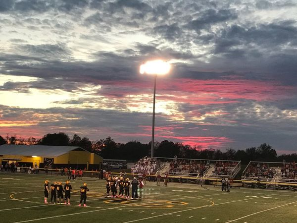 Woodford Co football Football Sky Cloud - Sky Large Group Of People Sport Real People Sunset Floodlight Competitive Sport Sports Team Outdoors Sportsman Men Teamwork