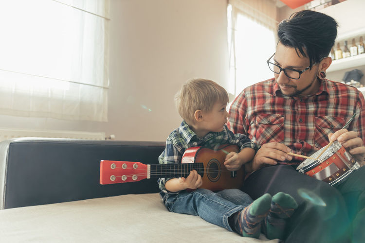 Father and son sitting in kitchen