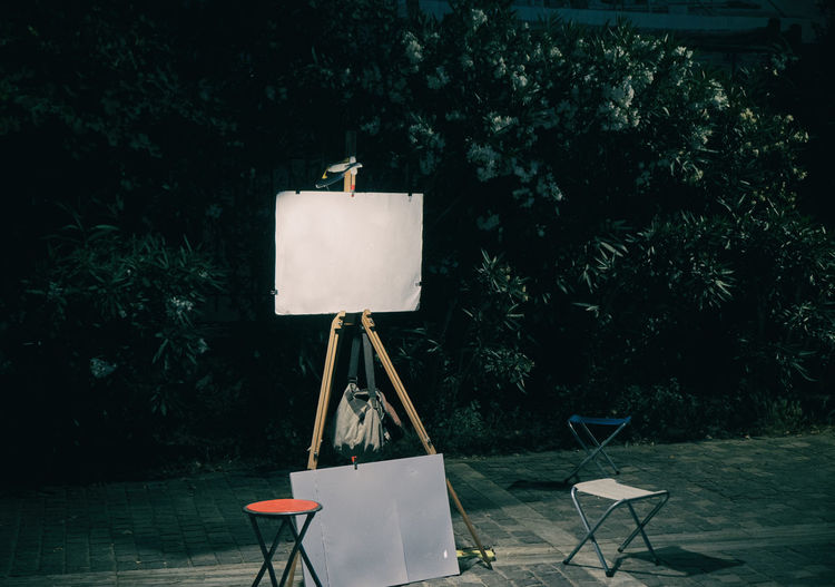 Paintings Nobody Medium Shape Color Gallery Horizontal Square Canvas Tripod Three Art Reflection Board Creativity Announce Gear Picture Blank Black White Objects Paint Descriptive Background Empty Frame STAND Easel Information Display Paintbrush Presenting Notice Portrait Vertical Artist Image