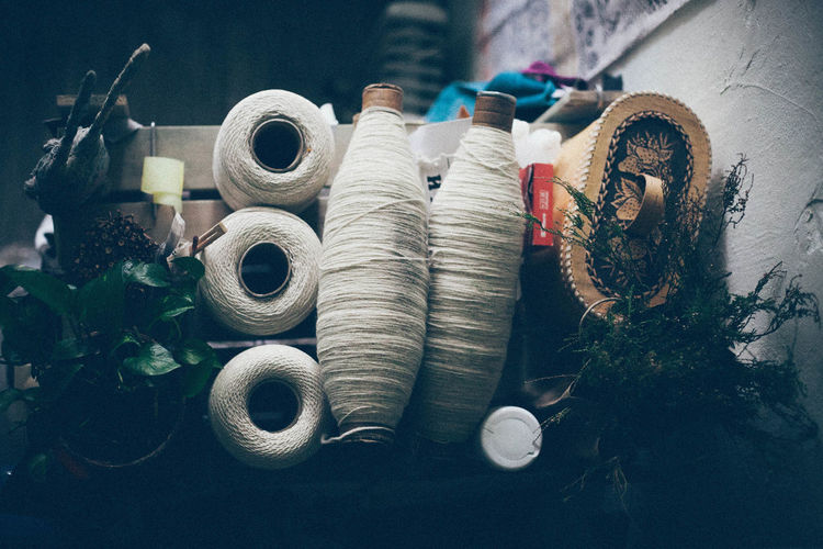 Close-Up Of White Spools At Home