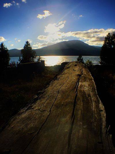 Lake Water Tranquil Scene Wood - Material Tranquility Scenics Pier Mountain Sky Non-urban Scene Lakeshore Idyllic Beauty In Nature Plank Wooden Nature Calm Remote Mountain Range