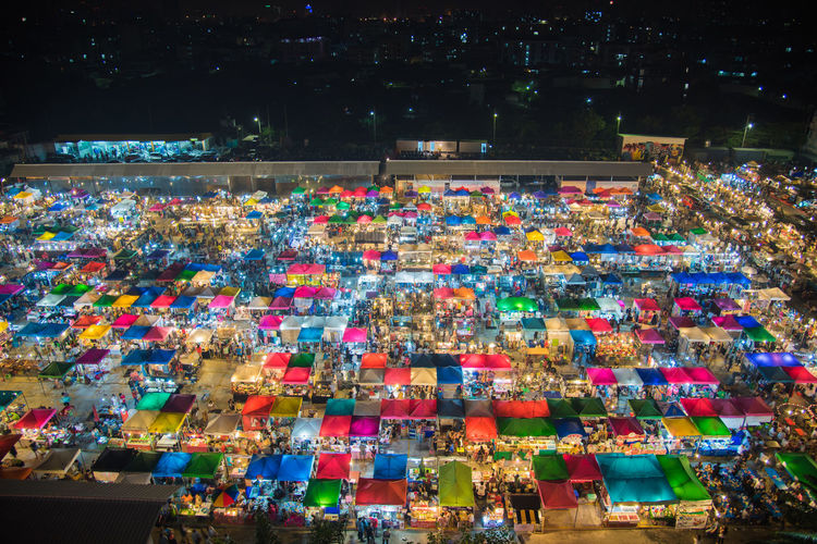 High angle view of illuminated colorful markets at night