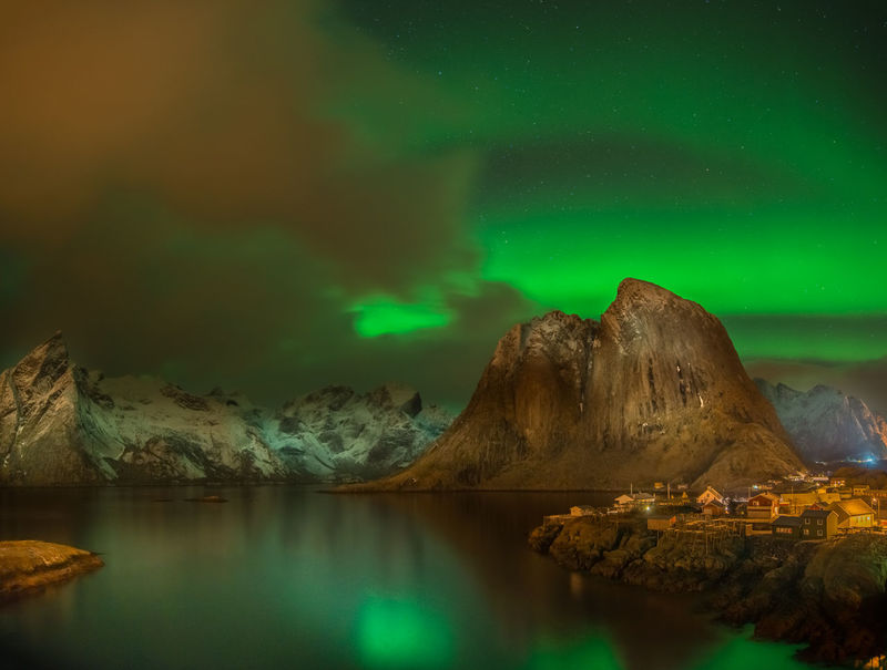 Northern lights above the fishing village of Hamnøy ( Hamony ) near Reine in the Lofoten area of Norway Aurora Aurora Borealis Northern Lights Reine Aurora Polaris Beauty In Nature Cloud - Sky Hamnøy Idyllic Lake Lofoten Mountain Nature Night No People Reflection Rock Scenics - Nature Sky Solid Star - Space Tranquil Scene Tranquility Water Waterfront