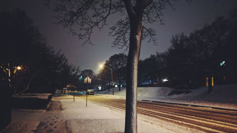 View of street at night during winter