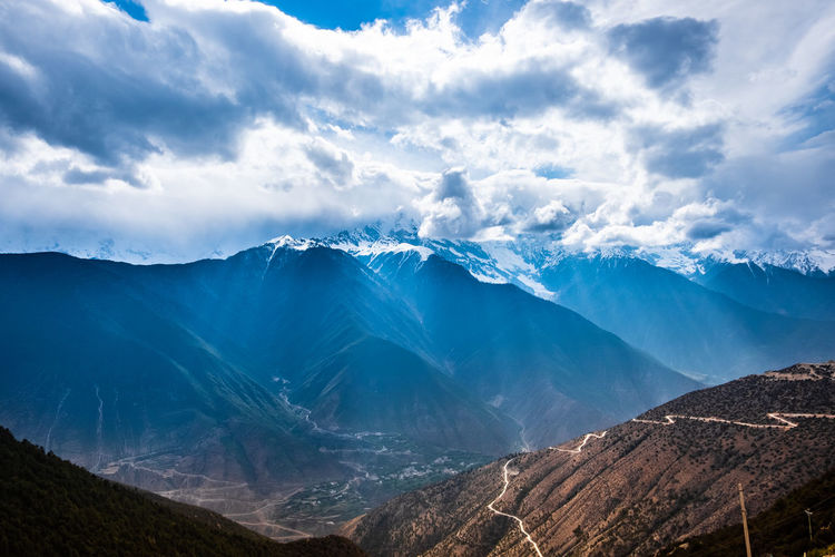 Cloud - Sky Mountain Scenics - Nature Sky Beauty In Nature Environment Mountain Range Tranquil Scene Landscape Tranquility Non-urban Scene Nature No People Day Cold Temperature Idyllic Snow Winter Outdoors Snowcapped Mountain Mountain Peak Mountain Ridge Meili DeQin Yunnan China Tibet Top High Fog Cool Cold
