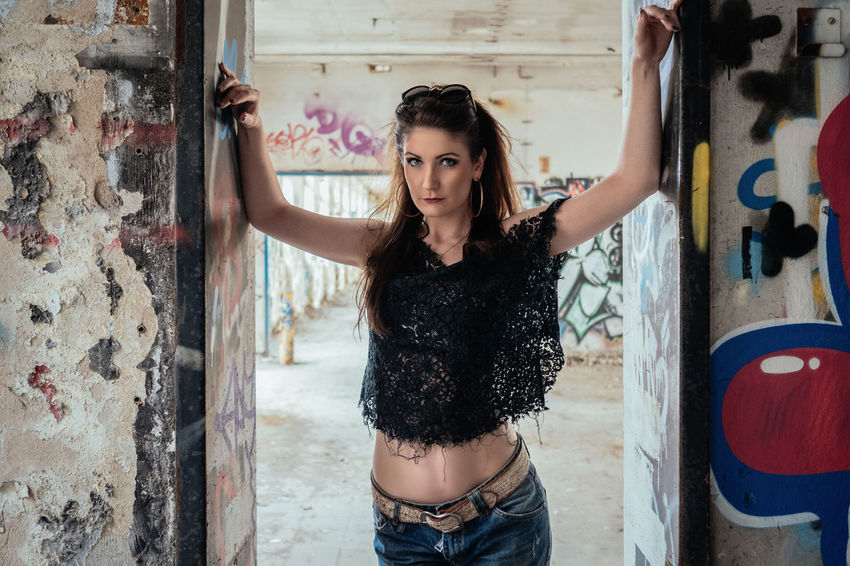 Confidence Abandoned Abandoned Buildings Abandoned Places Beautiful Beauty Casual Clothing Confidence  Cute Day Fashion Front View Glamour Jeans Leaning Lifestyles Long Hair Mode Model Person Portrait Standing Vogue Woman Young Adult Young Women