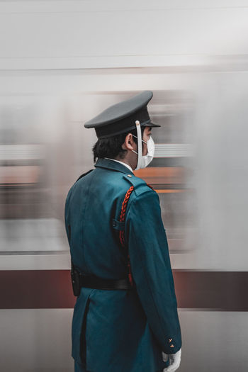 Train guard in Tokyo. Japan Photography The Street Photographer - 2018 EyeEm Awards The Traveler - 2018 EyeEm Awards Adult Blurred Motion Clothing Day Hat Leisure Activity Lifestyles Looking Away Men Motion One Person Outdoors Real People Rear View Standing Street Streetphotography Uniform Waist Up Week On Eyeem Young Men
