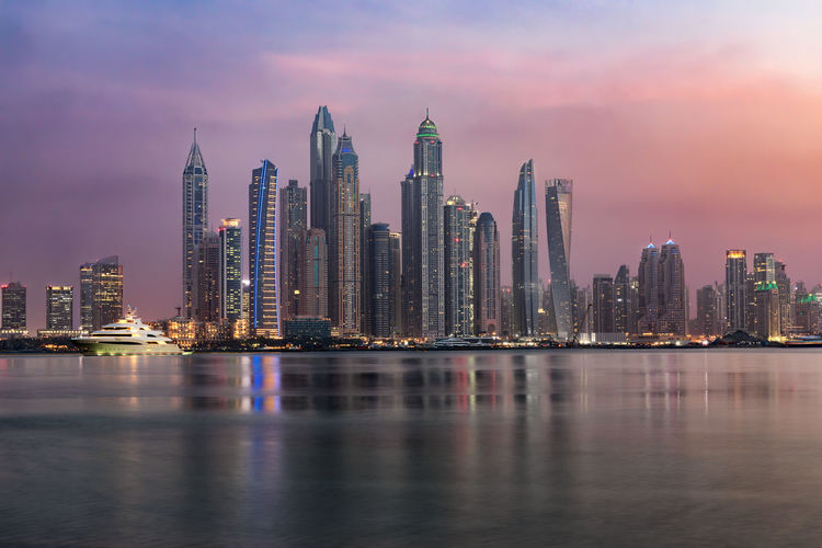 The Dubai Marina during sunset time, UAE Dubai Light Marina Sightseeing Tourist Attraction  Travel UAE Architecture Building Building Exterior Built Structure City Evening Financial District  Modern Reflection Sky Skyscraper Sunset Tall - High Tower Travel Destinations Urban Skyline Water Waterfront