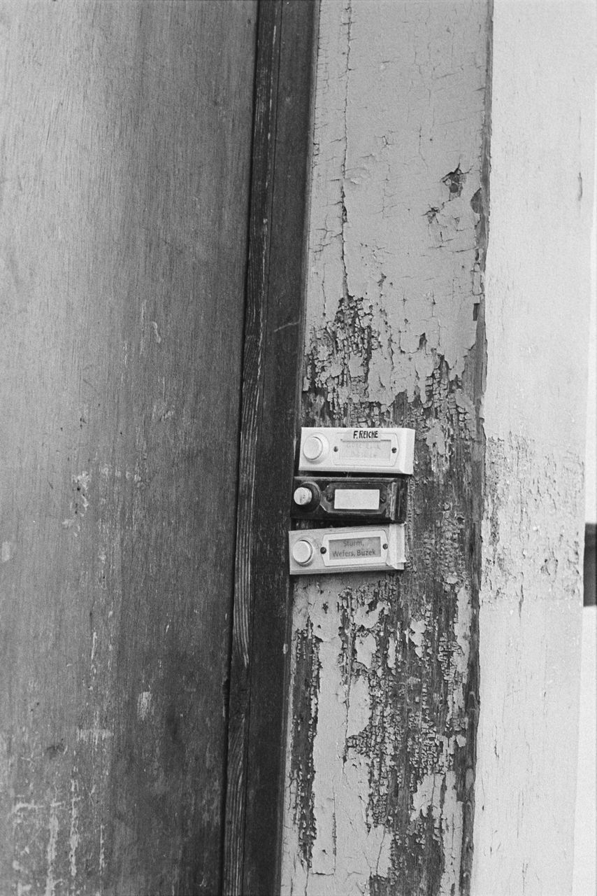 wood - material, door, entrance, no people, wall - building feature, old, close-up, metal, day, built structure, textured, mail slot, architecture, weathered, outdoors, protection, security, safety, mailbox, full frame