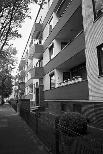 House from the Sixties in Bremerhaven Blackandwhite Photography Analogue Photography Analogue Photography Analog Analog Camera Point And Shoot Filmisnotdead Pentax Pentax Espio 120 Sw Kodak Kodak T-max 400 No People The Architect - 2018 EyeEm Awards City Tree Architecture Sky Building Exterior Built Structure Residential Structure Building Stairs Exterior Residential  Place Settlement Human Settlement
