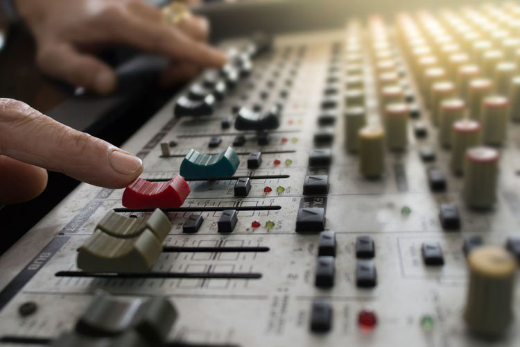 Human Hand Hand Human Body Part Music Audio Equipment Sound Mixer Sound Recording Equipment Technology Control Indoors  Arts Culture And Entertainment Control Panel People Real People Selective Focus Body Part Adjusting Push Button Studio Electronics Industry Finger Complexity Mixing Electrical Equipment